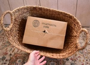 Find a box that will fit snugly inside of your woven basket.