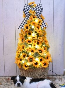Once the tree is well covered with sunflowers we can add our accents to finish the tree.