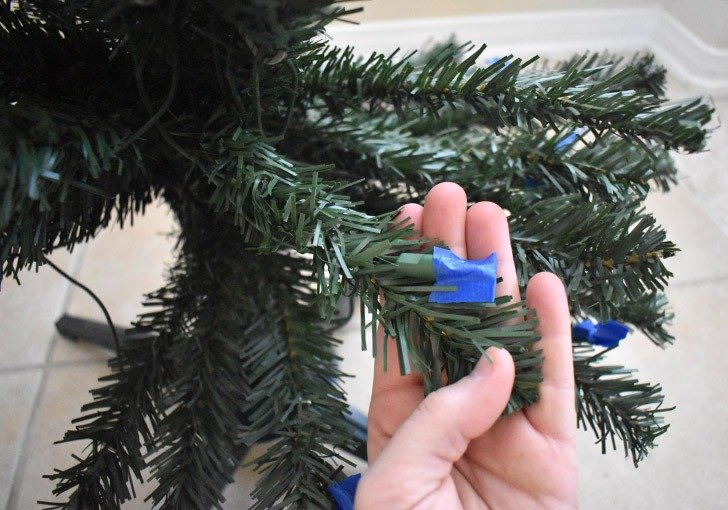 If your Christmas tree is pre-lit, you'll need to protect the lights from getting covered and obscured by the flocking.