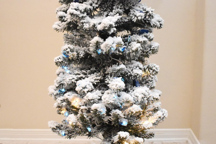 Give the flocking on your tree plenty of time to dry. Next, plug your Christmas lights in.