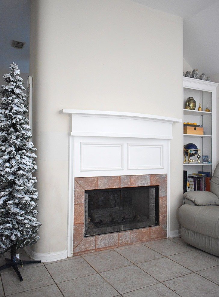 A total blank slate, this mantle and fireplace need some Christmas cheer, stat!