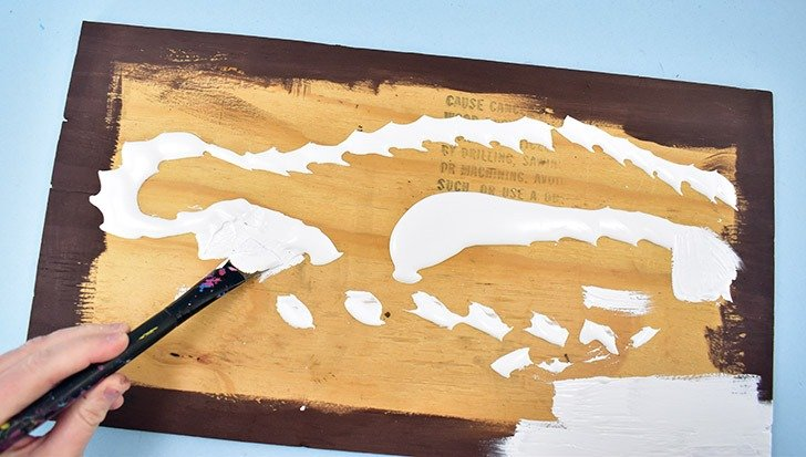 First, paint your darker color your board and allow the paint to dry. For this board, I only painted the edges but for my next, I covered the entire board with the undercoat. I strongly suggest painting the entire board. Next, paint over your first coat of paint with your primary paint color and allow it to dry. Add a second coat if needed and give it time to dry as well.