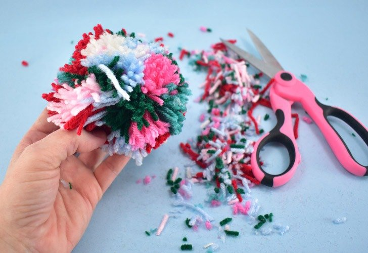 How to trim your pom poms for a round shape.
