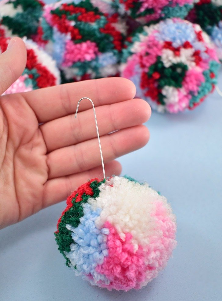 Should you need longer ornament hooks you can add a second to the first that is inside of the pom.