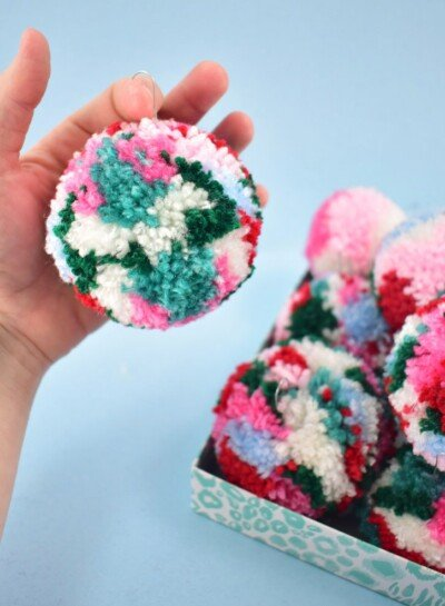 If you're looking to add some fun and color to your Christmas tree look no further. These DIY multicolored pom pom ornaments are adorable and inexpensive!