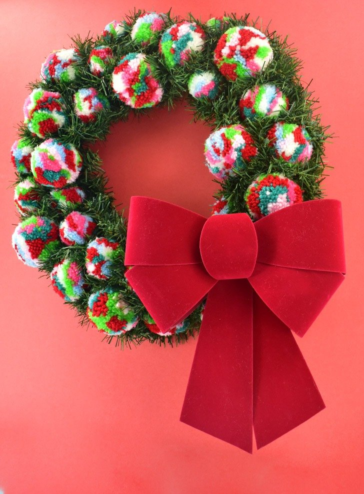 Want to add a little bit of color to your otherwise traditional Christmas decor? This pine and pompom wreath is gorgeous, easy and inexpensive!