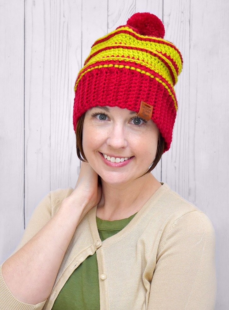 Grab the free pattern to make your own red and green Christmas Crochet Hat. And if you decide to make it in other colors, too, we won't be mad :)