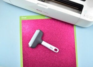 When working with less flexible or heavier materials a brayer helps to secure the item to the adhesive so it doesn't shift during cutting.