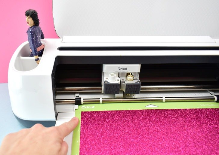 Loading the cutting mat into your Cricut is fool-proof with these convenient guides!
