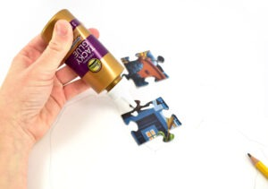 Grab your Tacky Glue and apply a dot of glue onto the end of a puzzle piece.