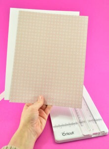 Using a Cricut Paper Trimmer is the easiest way to get scrapbooking paper down to size to run through your printer.