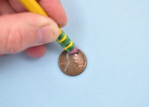 How to clean pennies with an eraser, the before and after.