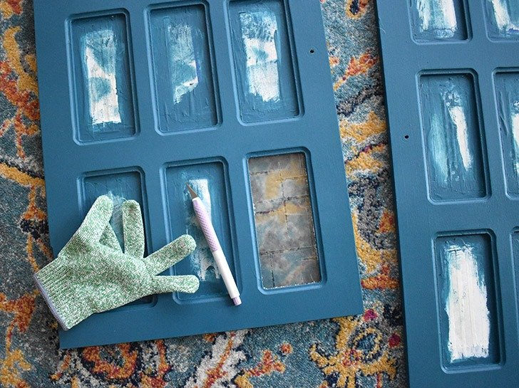 Carefully remove masking tape, using a craft knife in tight corners or crannies for a straight painted edge.