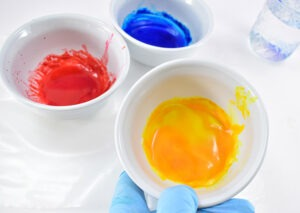 Continue mixing together your baking soda paints adding more food coloring to lighter colors such as yellow.