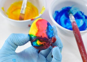 Cover the entire egg with food coloring paint. Don't worry about drips, it only adds to the pretty marbled effect in the end.