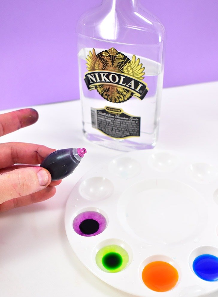 To make your edible Easter egg paint pour a splash of vodka or everclear into the well of a paint palette.