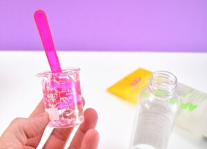 Measuring out your materials for DIY hand sanitizer.
