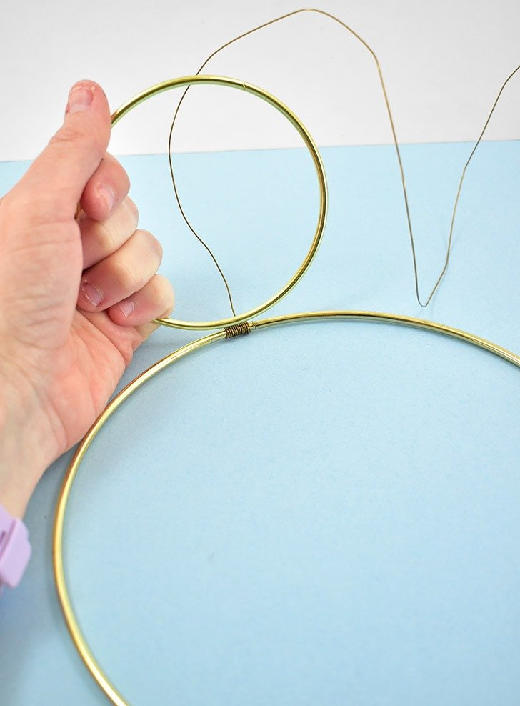 Place your smaller ring up against the wire wrap of your larger ring like seen above.