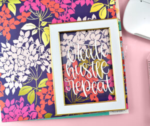 Now for the fun part! Grab a couple sheets of scrapbooking paper and your frame and cut design.