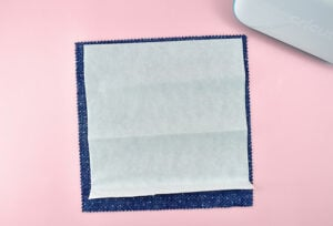Take a piece of fabric slightly larger than your mouse pad and place it pretty side down on you workspace.