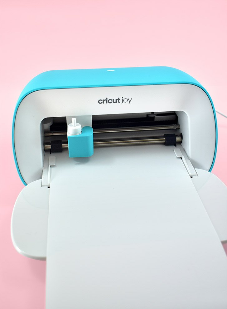 Load permanent Cricut Smart Vinyl into your Cricut Joy and cut the saying of your choosing.