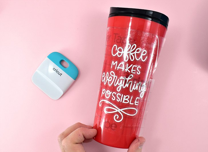 Carefully place the transfer tape and vinyl design in place on your mug.