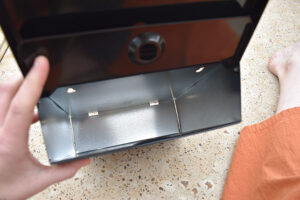 This is what the inside of your mailbox will look like... There are also two flaps on the top. One that is the decorative lid and another that locks in place.