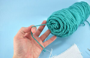 Pull your thread from the center of your skein if possible. This will help prevent some tension problems as you punch.