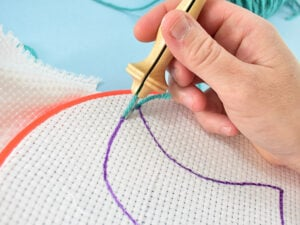 Carefully pull the needle straight up and away from the fabric, removing the tool just barely from the fabric itself.
