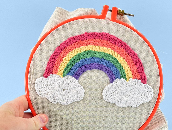 Fill in the clouds with white stitches to finish the design.