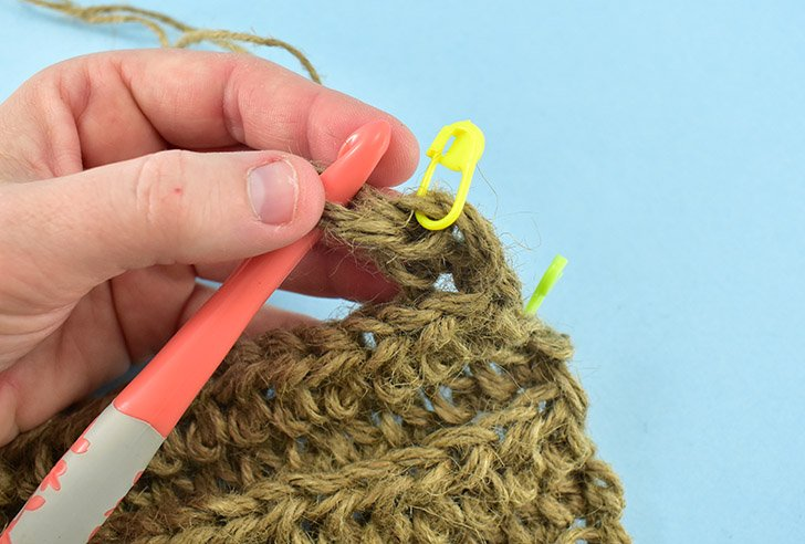 Half Double Crochet in the first stitch. Place a crochet stitch marker at the top of that stitch you just completed. Continue to the end making 1 half double crochet in every stitch. (55 st.)