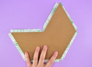 Flatten your top chipboard piece back out and lay on the backside of your printed paper.