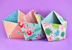 Too much stuff and not enough places to store it? Keep the little things organized with these DIY Chipboard Wall Pockets.