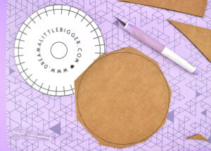 Using a sharp craft knife cut off the edges around the cardboard circle you just traced.