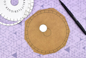 Cut the pattern down to the innermost circle. Place as near the center as you can by eye and trace.