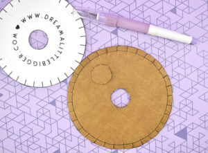 Use a sharp craft knife to remove the center circle.