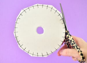 Use a pair of sharp scissors to trim the outermost circle. Number each of the slots 1-32. Place a filled in circle in the slot for 8, 16, 24, and 32 as a guide for cord placement.