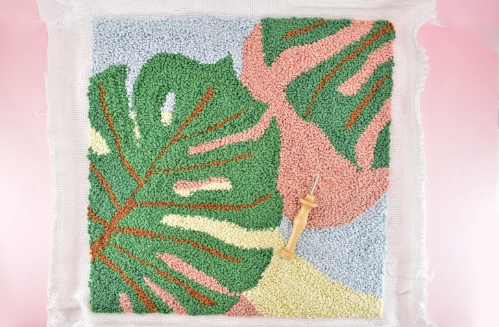 Your monstera punch needle piece is done and can be used as a framed art piece or sewn into a pillow!