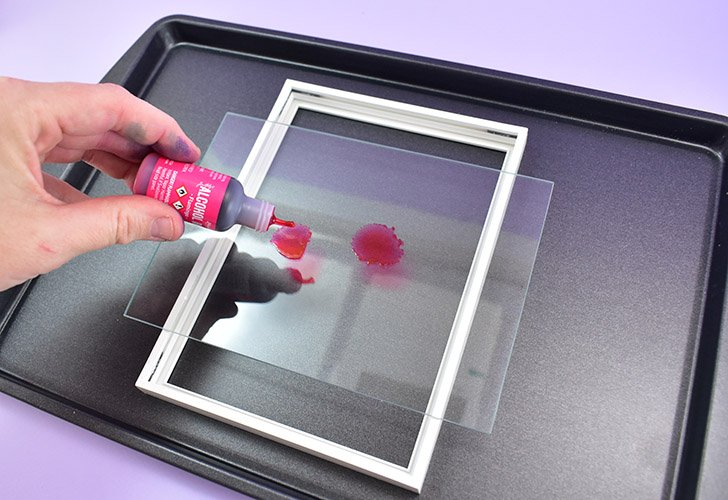 Remove the glass from your frame and clean well using glass cleaner. Allow to dry completely and place on top of a non-flammable work surface, like a cookie sheet.