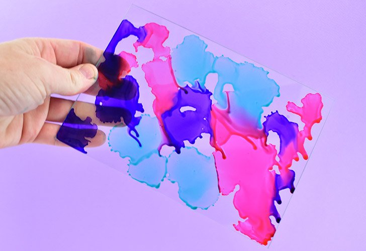 Pick up the glass and move around so that the colors merge and bleed into one another. You want to cover as much of the glass as you can in ink.