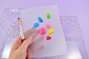 Select your craft acrylic paint colors and grab a soft bristled brush.