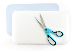 Place your paper pattern on top of your upholstery foam and trace it. Use sharp scissors or a utility knife to cut the shape out of the foam.