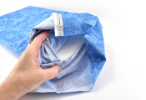 Turn your fabric pillow case right side out and put your foam inside.