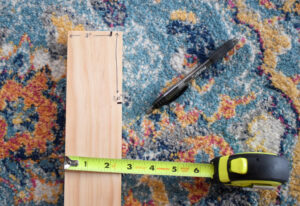 "Cut one end of the board at a 10° angle. This will be the bottom of your blanket ladder. To cut the top end of the ladder first mark 2"" from the front of the legs along the top of the board. From the top of the board measure and mark down at 3.25"" along the back side."