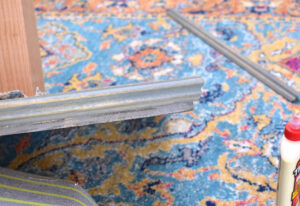 Place the moulding onto the base and secure in place with trim or wire nails.