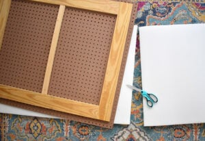 Place your upholstery foam onto your work surface. Place the headboard front side down on top. Trace and cut the foam to size.