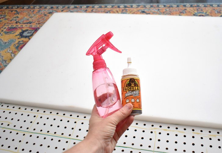 Using either Gorilla Glue and Water or Spray Adhesive, secure your foam to the front of your pegboard.