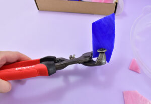 Grab your glass tile nippers and a piece of stained glass. With the nippers positioned like in the photo, nip random shapes, some smaller and some larger.