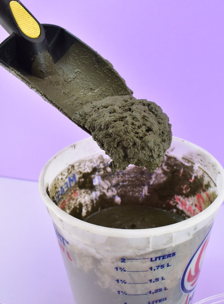 In a plastic container mix together your sand/topping mix and water. To prevent bubbles appearing on the surface you need a consistency that is somewhat thin. However, you don't want your cement to be too runny or it will seep under the glass and ruin the terrazzo effect.