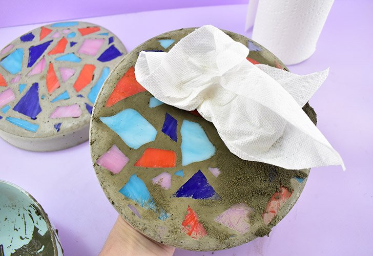Use a paper towel to wipe the excess cement off of the face of the stone. Allow the stone several hours to dry. Repeat the process if necessary for any remaining holes.